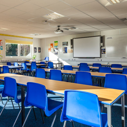 Modular classroom with desks and whiteboard