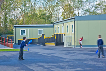 Upcycled modular classrooms and playground