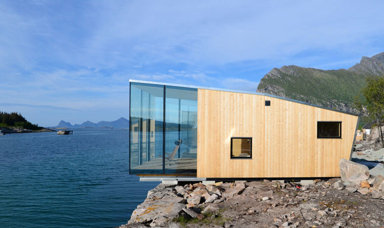 Holiday cabin modular building over coastline