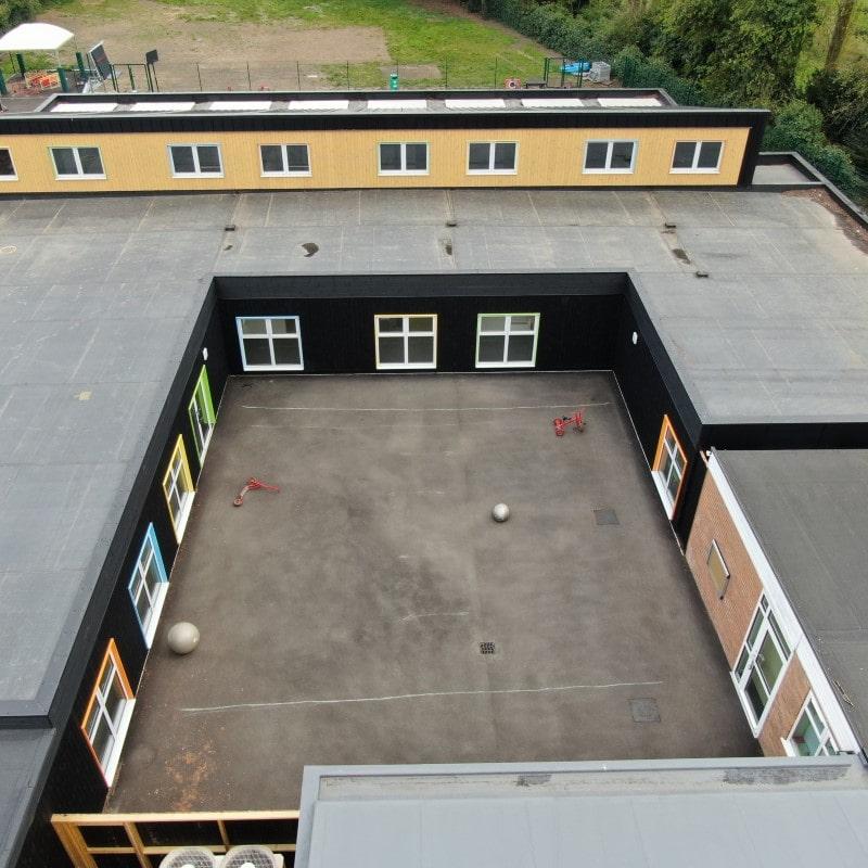 school modular building courtyard